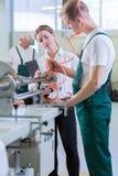 Engineer controlling machines. Female engineer controlling machines in production centre Royalty Free Stock Photo