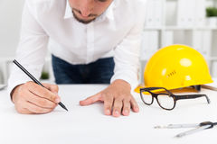 Engineer correcting mistake stock photo