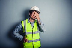 Engineer covering his face Royalty Free Stock Image