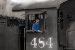Engineer of Cumbres & Toltec Scenic Steam Train, Chama, New Mexico to Antonito, Colorado over Cumbress Pass 10,015 Elevation. OCTOBER 9, 2018 - Chama, New Mexico royalty free stock photography