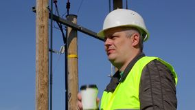 Engineer with cup of coffee at outdoor stock video footage