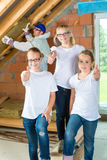 Engineer and daughters building top floor Stock Photography