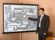 Engineer demonstrates new computer design Stock Photos