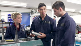 Engineer Demonstrating Machinery To Apprentices stock video