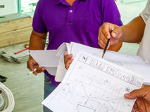 Engineer description to technician and looking plan Royalty Free Stock Image
