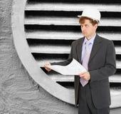 Engineer - designer in helmet with drawings Stock Image