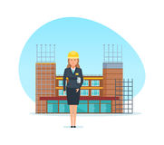 Engineer designer, with technical documentation, on background under construction building. Engineer designer girl, with technical documentation in hand, stands Stock Photography
