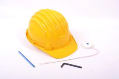 Engineer desk. An engineer desk with pen and helmet Royalty Free Stock Image