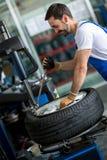 Engineer diagnostics tyre Stock Photography