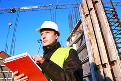Engineer and Director. Engineer checks the accuracy of data on the construction,photography Stock Photos