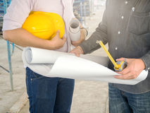 Engineer discussing with foreman. About project in building construction site, selective focus stock image