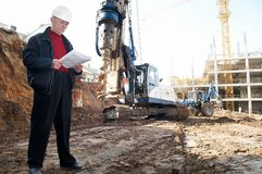 Engineer with documentation at. Builder inspector worker at construction site with documentation royalty free stock image