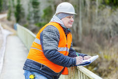 Engineer with documentation on the bridge Royalty Free Stock Image