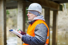 Engineer with documentation under the bridge Stock Photo