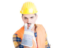 Engineer doing watching you or pay attention at me gesture. Young engineer with helmet doing watching you or pay attention at me gesture isolated on white Royalty Free Stock Image