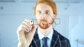 Engineer Drawing Car Concept on Transparent Glass in Office, Red Hairs. 4k , high quality stock photo