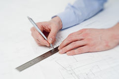 Engineer drawing a line Stock Photos
