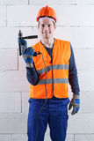 Engineer with the drill. Vertical view of an engineer with the drill Stock Photography
