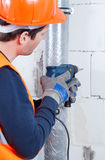 Engineer drilling in the wall Royalty Free Stock Photo