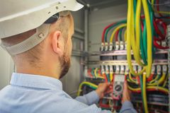 Free Engineer Electric Measures Multimeter Voltage Of High-power Electrical Circuits. Royalty Free Stock Photography - 100315827