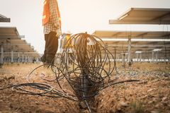 Engineer and electrician installing solar tracking power plant. Scope of work at solar power plant tracking to sun Royalty Free Stock Image