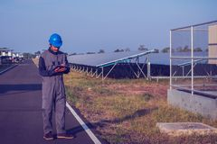 Engineer or electrician working on checking and inspect equipmen. T with checklist at outdoor industry royalty free stock image