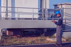 Engineer or electrician working on checking and inspect equipmen. T with checklist at outdoor industry royalty free stock photography
