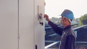 Engineer or electrician working on checking and maintenance equi. Pment at green energy solar power plant; checking status step up transformer high voltage at royalty free stock photos