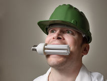 Engineer with Energy Saving Lightbulb Royalty Free Stock Photography