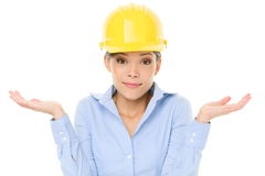 Engineer, entrepreneur or architect woman shrugging. Lifting shoulders in doubt about decision. Young female mixed race Caucasian / Asian professional shrug Royalty Free Stock Images