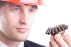 Engineer examine a gear Royalty Free Stock Photos