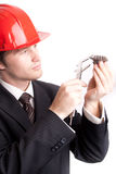 Engineer examine a gear Royalty Free Stock Image