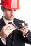 Engineer examine gears Royalty Free Stock Images