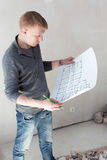 An engineer examining blueprints. On a construction site royalty free stock photo