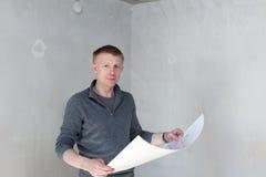 An engineer examining blueprints Royalty Free Stock Image