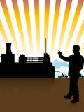 Engineer and factory. On sunburst background Royalty Free Stock Photos