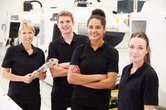 Engineer In Factory With Apprentices Checking Components Stock Photos