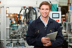 Engineer In Factory Holding Digital Tablet Royalty Free Stock Image