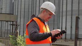 Engineer at the factory working with tablet stock footage