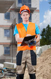 Engineer filling papers at building site Royalty Free Stock Photo