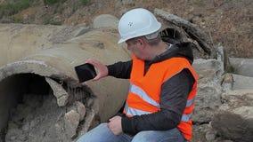 Engineer filmed the broken concrete pipe stock footage