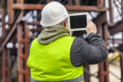 Engineer filmed with tablet PC in factory Stock Image