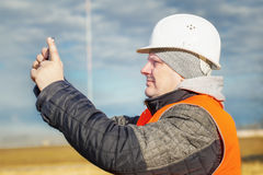 Engineer filmed with tablet PC at outdoors. In autum day stock image