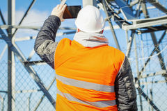 Engineer filmed with tablet PC at outdoors Royalty Free Stock Photos