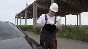Engineer finishing check unfinished building. In summer day stock footage