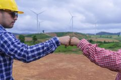 Engineer fist bump finish up contract deal, Mission complete wit royalty free stock photos