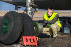 Engineer fixing aircraft's wheel Royalty Free Stock Photos