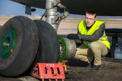 Engineer fixing aircraft's wheel Royalty Free Stock Photography