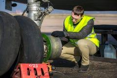 Engineer fixing aircraft's wheel