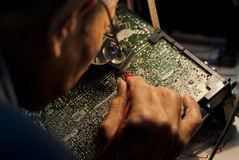 Engineer fixing an analog television circuit board Stock Photography